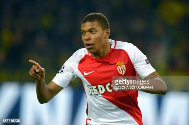 TOPSHOT Monaco's French forward Kylian Mbappe Lottin reacts after scoring during the UEFA Champions League 1st leg quarterfinal football match BVB...