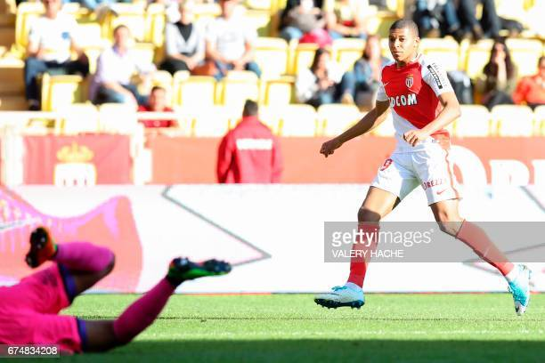 Monaco's French forward Kylian Mbappe Lottin scores a goal during the French L1 football match Monaco vs Toulouse on April 29 2017 at the 'Louis II...
