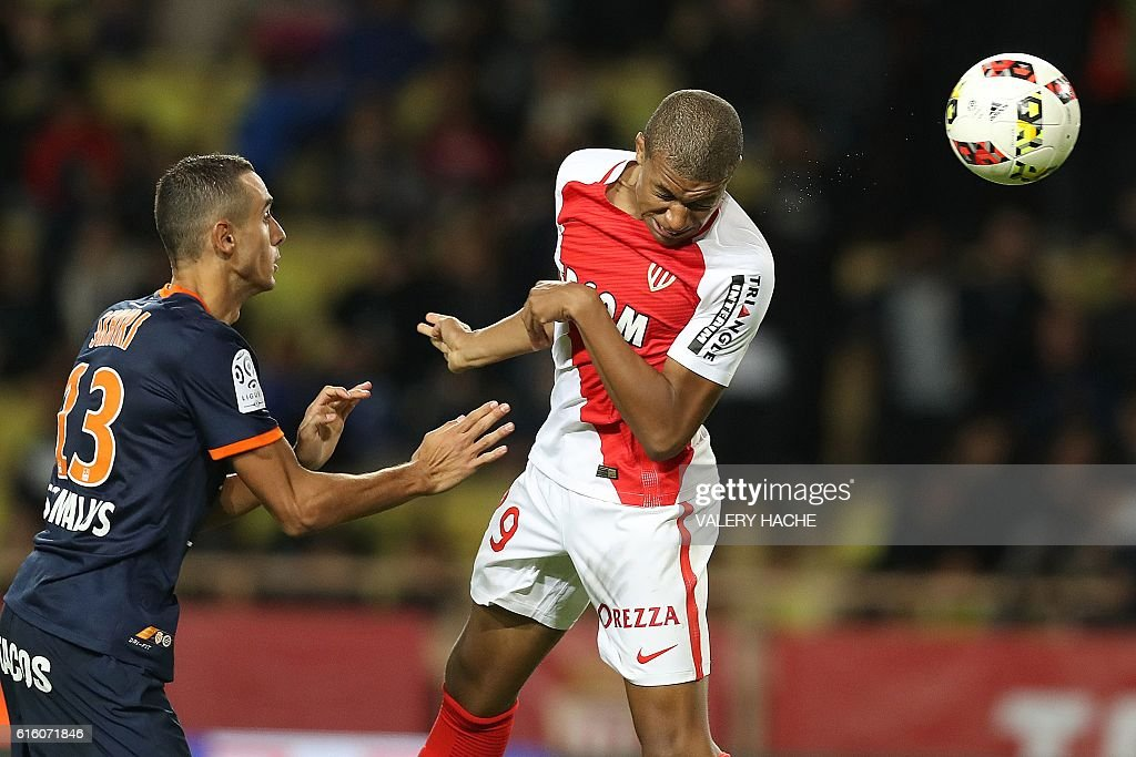 Monaco's French forward Kylian Mbappe Lottin (R) scores a header next to Montpellier's French defender Ellyes Skhiri during the French L1 football match between AS Monaco and Montpellier at the Louis II Stadium in Monaco on October 21, 2016. / AFP / VALERY