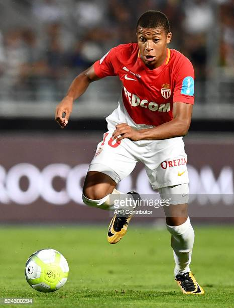 Monaco's French forward Kylian Mbappe runs with the ball the ball during the French Trophy of Champions football match between Monaco and Paris...