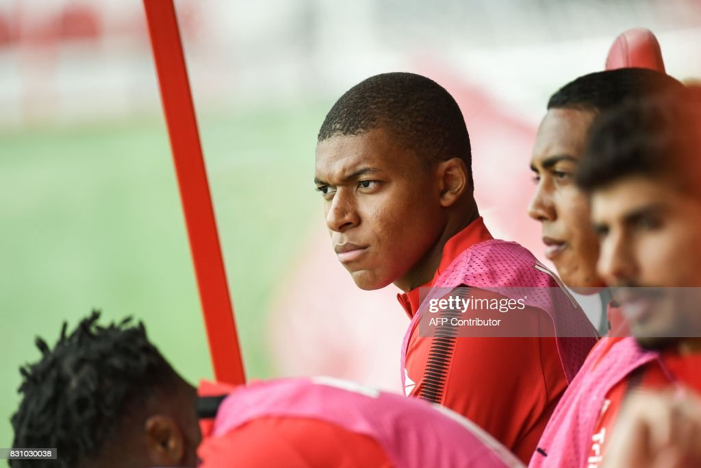 Monaco's French forward Kylian Mbappe (C) sits on the bench during the French Ligue 1 football match between Dijon FCO and AS Monaco, on August 13, 2017 at Gaston Gerard stadium in Dijon, northern France. /