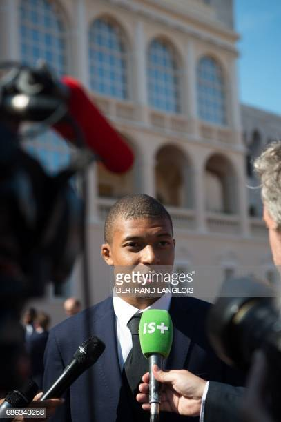 Monaco's French forward Kylian Mbappe speaks to journalists as hes arrives at the Prince's Palace in Monaco on May 21 to attend celebrations to mark...