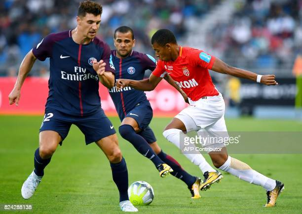 Monaco's French forward Kylian Mbappe vies for the ball with Paris SaintGermain's Belgian defender Thomas Meunier and Paris SaintGermain's Brazilian...