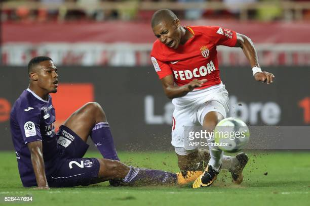 Monaco's French forward Kylian Mbappe vies with Toulouse's French defender Kelvin Amian during the French L1 football match between Monaco and...