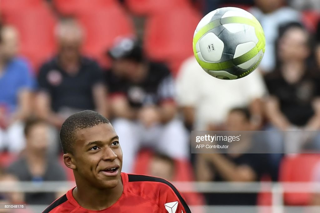 Monaco's French forward Kylian Mbappe warms up prior to the French Ligue 1 football match between Dijon FCO and AS Monaco, on August 13, 2017 at Gaston Gerard stadium in Dijon, northern France. /