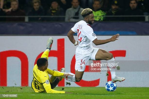 Monaco's French forward Moussa Sylla gets past Dortmund's Swiss defender Manuel Akanji during the UEFA Champions League Group A football match BVB...