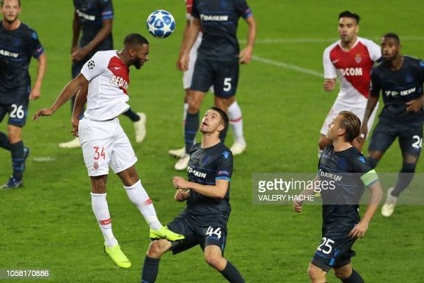 Monaco's French forward Moussa Sylla heads the ball past Club Brugge's Belgian defender Brandon Mechele during the UEFA Champions League Group A...