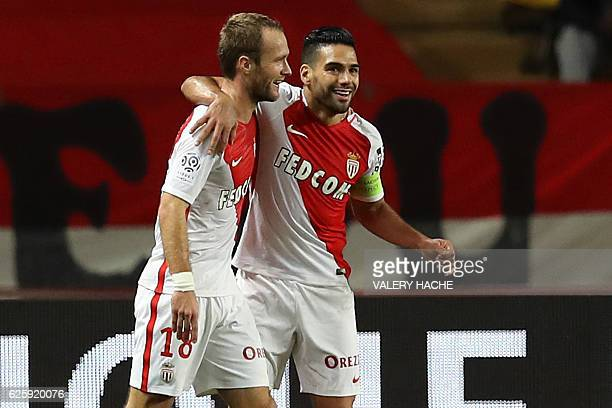 Monaco's French forward Valere Germain celebrates with Monaco's Colombian forward Radamel Falcao after scoring a goal during the French L1 football...