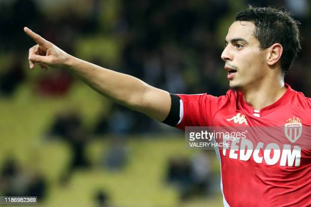 Monaco's French forward Wissam Ben Yedder celebrates after scoring a goal during the French L1 football match between Monaco and Amiens at the Louis...