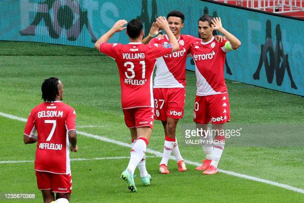 Monaco's French forward Wissam Ben Yedder celebrates with team mates after scoring a goal during the French L1 football match between Monaco and...