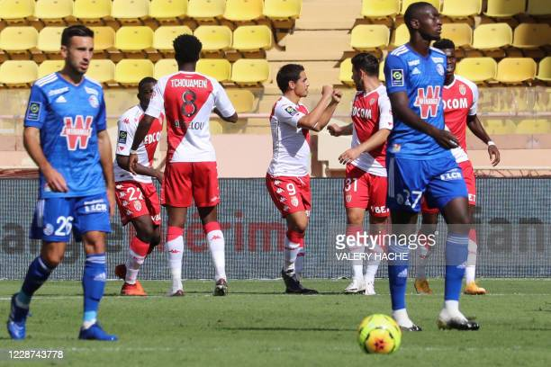 Monaco's French forward Wissam Ben Yedder celebrates with teammates after scoring a goal during the French L1 football match between Monaco and...