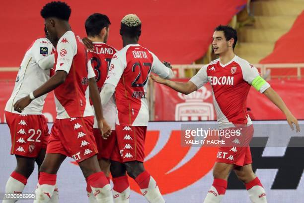 Monaco's French forward Wissam Ben Yedder celebrates with teammates after scoring during the French L1 football match between AS Monaco and OGC Nice...