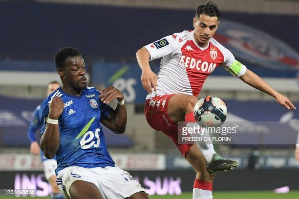 Monacos French forward Wissam Ben Yedder fights for the ball with Strasbourgs Ivorian defender Lamine Kone during the French L1 football match...