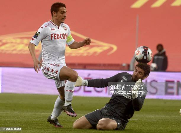 Monaco's French forward Wissam Ben Yedder fights for the ball with Lens' French goalkeeper Jean-Louis Leca during the French L1 football match...