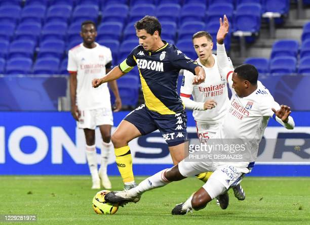 Monaco's French forward Wissam Ben Yedder is tackled by Lyon's Brazilian defender Marcelo during the French L1 football match between Olympique...