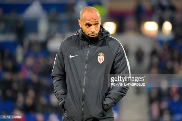 MonacoÕs French head coach Thierry Henry reacts during the French L1 football match between Lyon and Monaco on December 16 at the Groupama Stadium in...