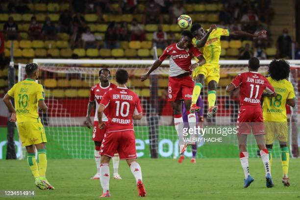 Monaco's French midfielder Aurelien Tchouameni fights for the ball with Nantes' French forward Randal Kolo Muani during the French L1 football match...