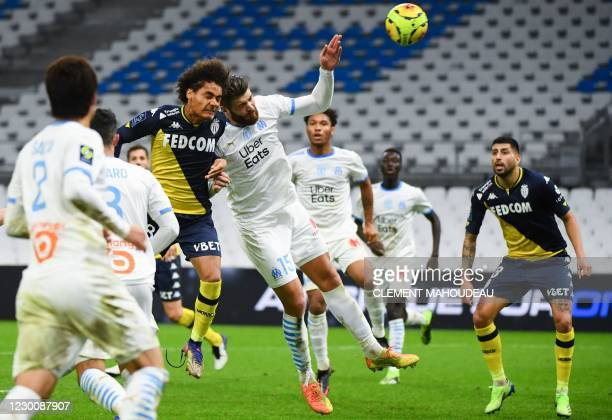 Monacos French midfielder Enzo Millot fights for the ball with Marseille's Croatian defender Duje Caleta-Car during the French L1 football match...