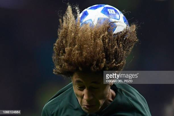 TOPSHOT Monaco's French midfielder HanNoah Massengo heads the ball during the UEFA Champions League group A football match between Atletico Madrid...