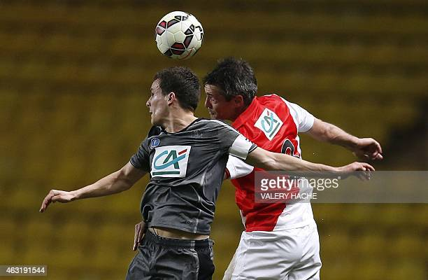 Monaco's French midfielder Jeremy Toulalan vies with Rennes' French defender Romain Danze during the French Cup football match Monaco vs Rennes at...