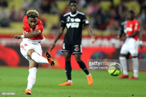 Monaco's French midfielder Moussa Sylla shoots the ball during the French L1 football match Monaco vs Amiens on April 28 2018 at the 'Louis II...