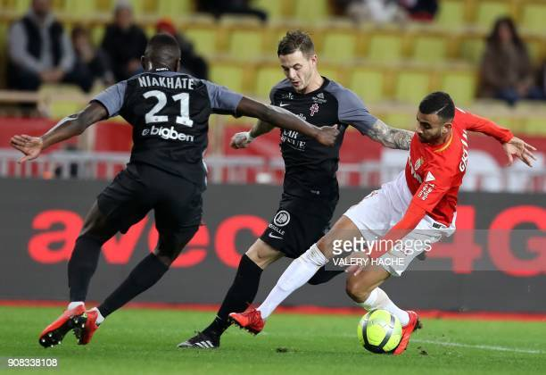 Monaco's French midfielder Rachid Ghezzal vies with Metz' French defender Moussa Niakhate during the French L1 football match Monaco versus Metz on...