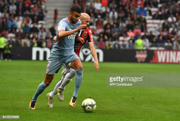 Monaco's French midfielder Rachid Ghezzal vies with Nice's French defender Christophe Jallet during the French L1 football match Nice vs Monaco on...