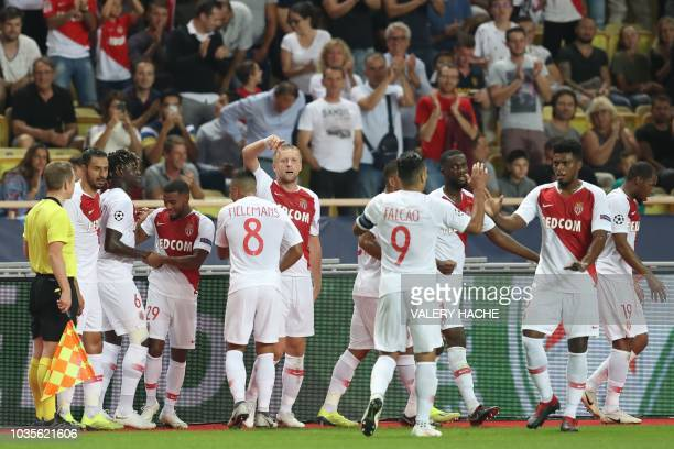 Monaco's French midfielder Samuel Grandsir celebrates with teammates after scoring a goal during the UEFA Champions League first round football match...