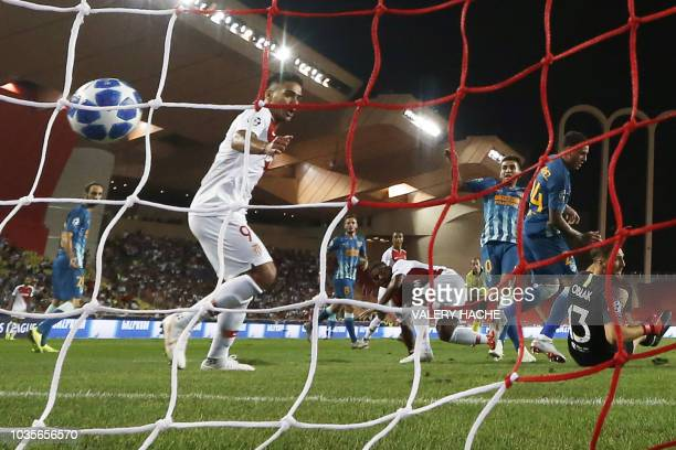 Monaco's French midfielder Samuel Grandsir shoots and scores a goal during the UEFA Champions League first round football match between AS Monaco and...