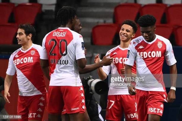 Monaco's French midfielder Sofiane Diop is congratulated by teammates after scoring a goal during the French L1 football match between Paris-Saint...