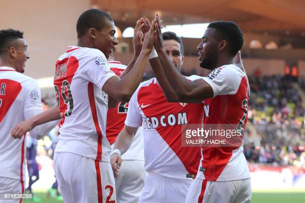 Monaco's French midfielder Thomas Lemar celebrates after scoring a goal with Monaco's French forward Kylian Mbappe Lottin during the French L1...