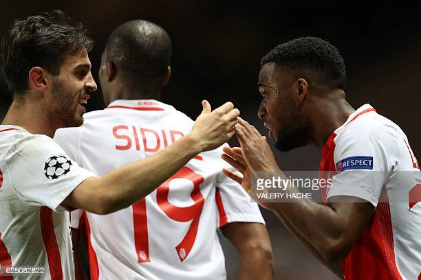 Monaco's French midfielder Thomas Lemar celebrates with Monaco's Portuguese midfielder Bernardo Silva after scoring during the UEFA Champions League...