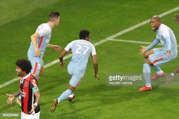 Monaco's French midfielder Thomas Lemar celebrates with teammates after scoring a goal during the French League Cup football match between Nice and...