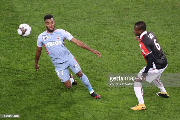 Monaco's French midfielder Thomas Lemar fights for the ball with Nice's Ivorian midfielder Jean Michael Seri during the French League Cup football...