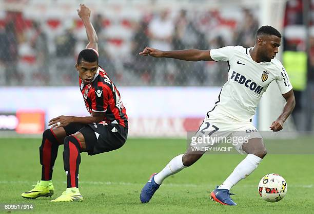 Monaco's French midfielder Thomas Lemar vies with Nice's Brazilian defender Dalbert Henrique during the French L1 football match between Nice and...