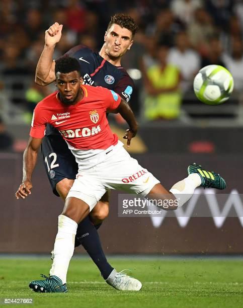 Monaco's French midfielder Thomas Lemar vies with Paris SaintGermain's Belgian defender Thomas Meunier during the French Trophy of Champions football...