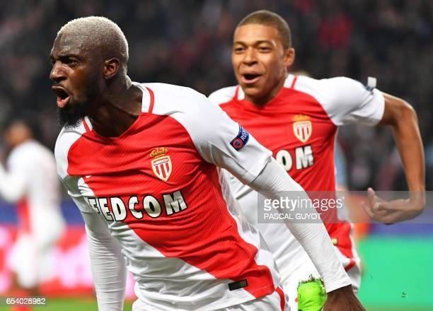 Monaco's French midfielder Tiemoue Bakayoko celebrates with Monaco's French forward Kylian Mbappe Lottin after scoring a goal during the UEFA...