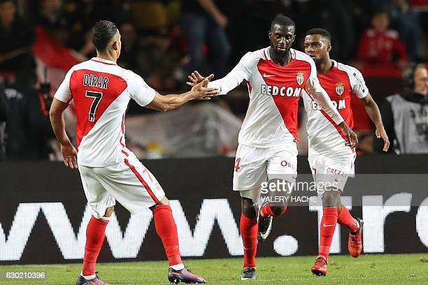 Monaco's French midfielder Tiemoue Bakayoko celebrates with teammates after scoring a goal during the French L1 football match between AS Monaco and...