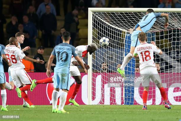Monaco's French midfielder Tiemoue Bakayoko scores a header during the UEFA Champions League round of 16 football match between Monaco and Manchester...