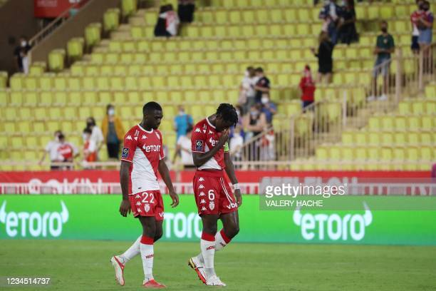 Monaco's French midfielder Youssouf Fofana and Monaco's French defender Axel Disasi leave the pitch at the end of the French L1 football match...