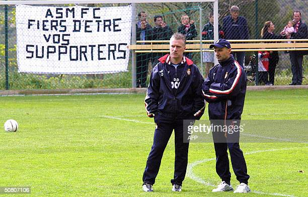 Monaco's French trainer Didier Deschamps and Italian fitness coach Antonio Pintus watch their team during a training session the day after their...