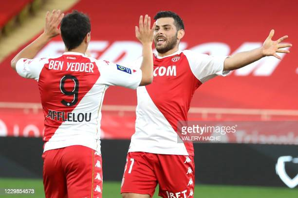 Monaco's German forward Kevin Volland celebrates after scoring a goal with Monaco's French forward Wissam Ben Yedder during the French L1 football...