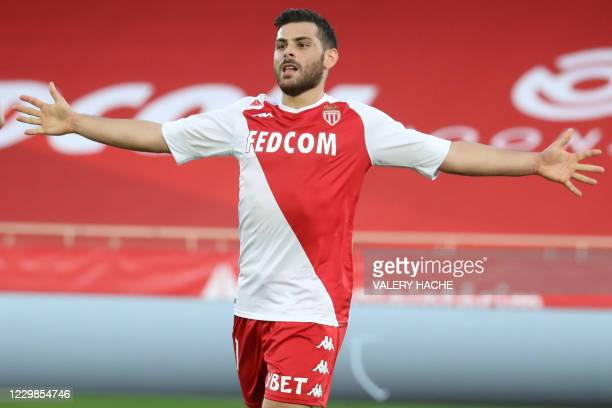 """Monaco's German forward Kevin Volland celebrates scoring his team's third goal during the French L1 football match Monaco and Nimes at """"Louis II""""..."""