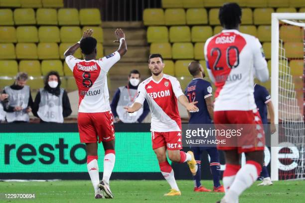 Monaco's German forward Kevin Volland celebrates with Monaco's French midfielder Aurelien Tchouameni after scoring a goal during the French L1...