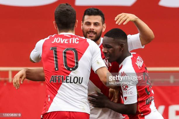 Monaco's German forward Kevin Volland celebrates with teammates after scoring a goal during the French L1 football match between AS Monaco and FC...