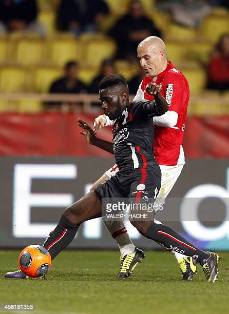Monaco's Italian defender Andrea Raggi challenges Valenciennes' French defender Fuka Arthur Masuaku during the French L1 football match between...