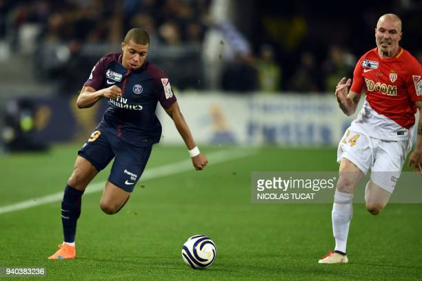 Monaco's Italian defender Andrea Raggi chases Paris SaintGermain's French forward Kylian Mbappé during the French League Cup final football match...