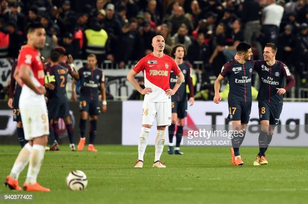 Monaco's Italian defender Andrea Raggi looks on as Paris SaintGermain's Spanish defender Yuri Berchiche and Paris SaintGermain's Argentinian...