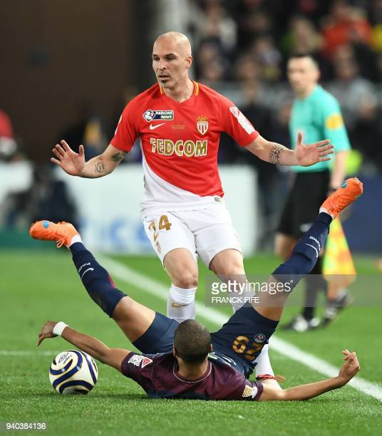 Monaco's Italian defender Andrea Raggi reacts after a tackle on Paris SaintGermain's French forward Kylian Mbappé during the French League Cup final...