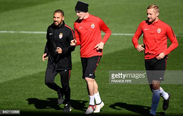 Monaco's Italian defender Andrea Raggi speaks with Monaco's Polish defender Kamil Glik during a training session at the Matmut Atlantique Stadium in...